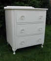 A classic-shaped bedside cabinet with glass knobs - SOLD